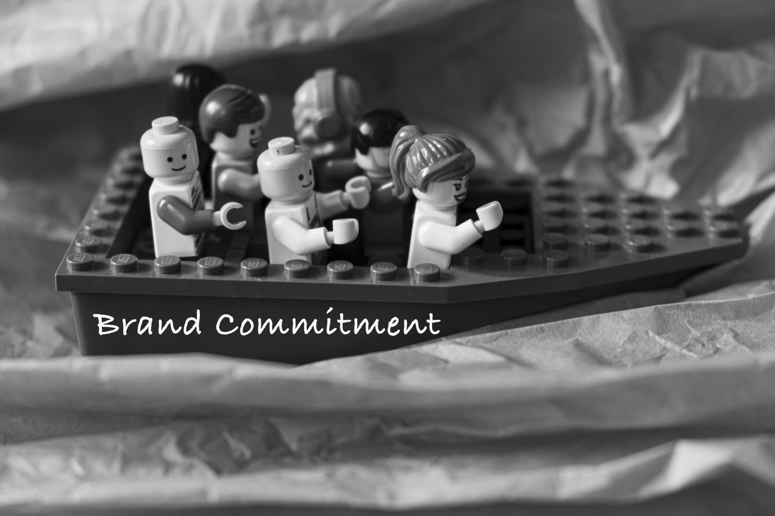 """Some brick figures on a boat called """"Brand Commitment"""""""