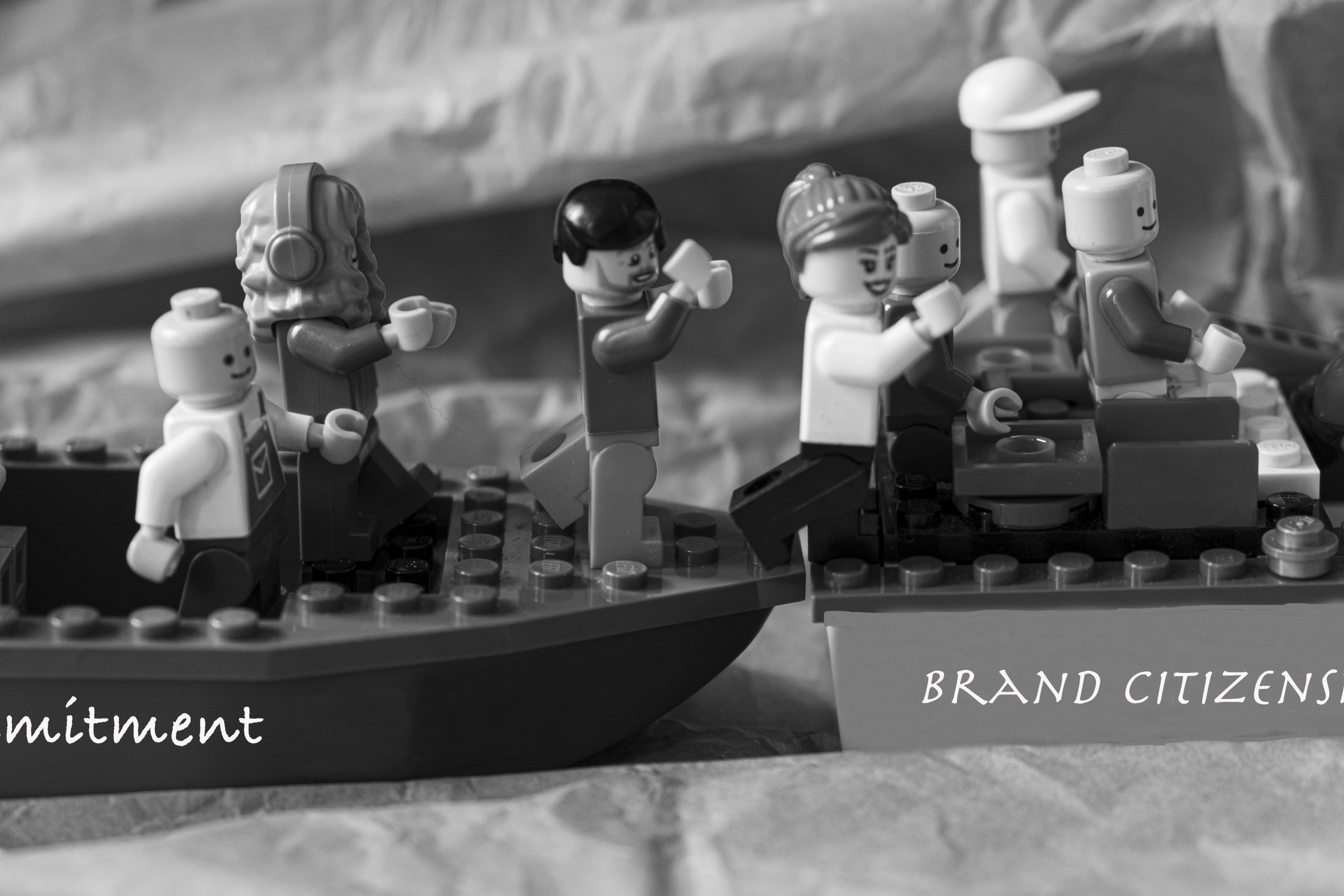 """Brick figures move from the """"Brand Commitment"""" boat to the """"Brand Citizenship Behaviour"""" boat"""