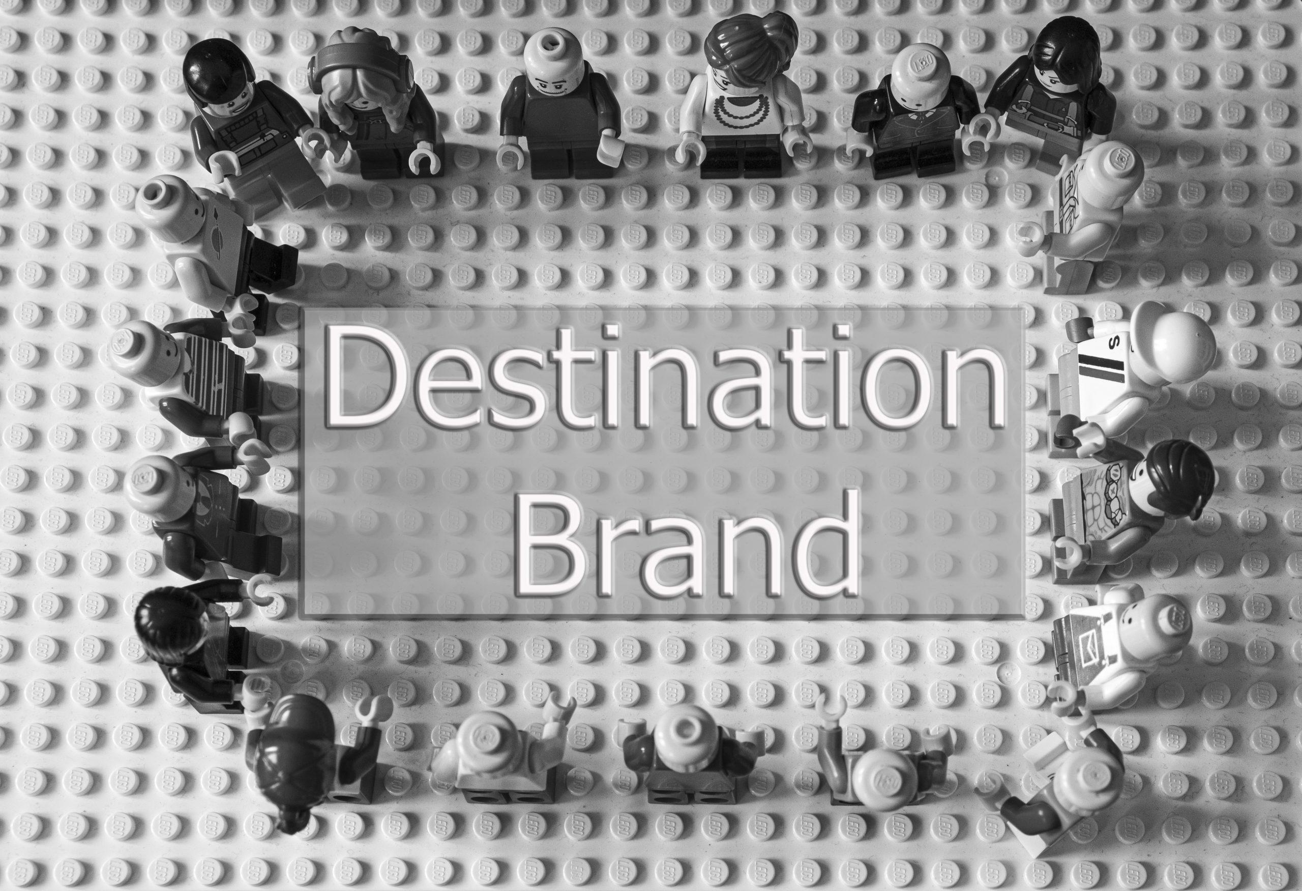 """All brick figures surround """"Destination Brand"""""""